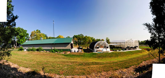 A panoramic view of the greenhouses and barns